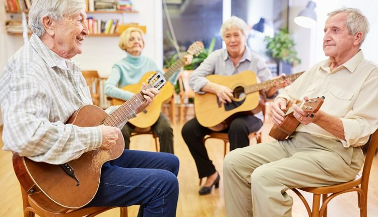 A group of seniors are playing guitar. Music is very important in old age